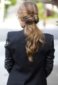 Easy Ponytail Hairstyles - Try this ponytail on second day hair. Make a low, loose ponytail, and then split the hair above the elastic in half. Pull your ponytail through the opening, and you're left with this sophisticated look.