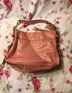 Coach patent leather, light pink, big buckle purse. Does have three small pen marks on front as noted in the picture. The inside lining is fair, but in good condition. Very nice purse. Best Purses, Small Pen, Vintage Coach, Coach Purses, Patent Leather, Nice, Coach Purse