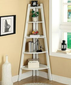 With a clean finish accentuating the tones of the solid wood construction, this display stand is sure to look elegant wherever it's placed. It features five shelves for storing books, media, magazines and more as well as a triangular design that conveniently fits in any corner of the home.