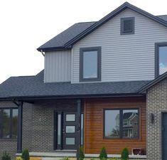 Mastic Deep Granite Grey siding, Black trim, black roof, real cedar siding on this home in Peoria IL Dark Siding House, Black Trim Exterior House, Grey House White Trim, House Trim, Grey Exterior, Grey Trim, Exterior Siding, Modern Exterior, Grey Brick Houses