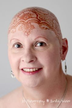This lovely lady is a dear old friend of mine who has been battling cancer for years. Chemotherapy robbed her of her hair but not her grace. This fantastic portrait was taken after she received a henna crown on her head. Doesn't she look beautiful! Henna Art by Hollie Urbauer @ http://hennabella.net/ . Photo by L.T. Photography.