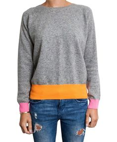 Neon Cashmere Jumper. We're madly in love with this jumper! It combines 100% classic cashmere with flashes of supercool neon for a modern, fashion forward look.  It comes in neon speckle mid grey with neon pink cuffs and neon orange waistband. £145  #cashmere #sweater #jumper #neon #gifts #ideas #luxury