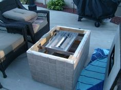 How to build a natural gas or propane outdoor fire pit using fireglass toppers or glass.
