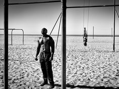 A man and woman exercise on Muscle Beach in Santa Monica, California, in this National Geographic Photo of the Day.