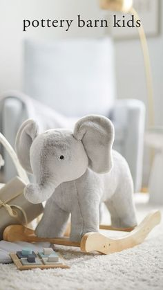 Little ones can go on a make-believe jungle adventure with our super plush critter elephant rocker. Sweet and huggable, it features solid wood handles and precision-shaped runners for a smooth, secure and gentle rocking motion. Make Believe, Baby Safe, Baby Registry, Pottery Barn Kids, Baby Gear, Little Ones, Baby Gifts, Dinosaur Stuffed Animal, Elephant