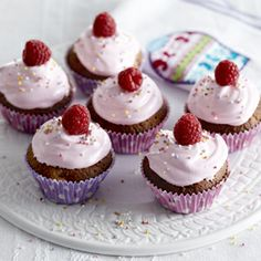 Pink, fluffy frosting makes these cupcakes extra special. They'd be perfect for a little girl's birthday party, too. White Chocolate Raspberry, White Chocolate Chips, Marshmallow Cupcakes, Paper Cupcake, Cupcake Cookies, Sweet Recipes, Cake Recipes, Cupcake Toppings, Pink