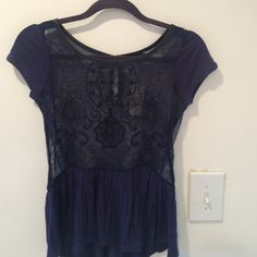 American Eagle navy blue peplum blouse Navy blue American Eagle blouse with intricate black beading and embroidery detail.  Size is xxs but will fit an xs and small.  Last picture is the back of the shirt which is sheer to the peplum with a keyhole detail. Comes with tags and extra beading for repairs.  Brand new never worn American Eagle Outfitters Tops Blouses