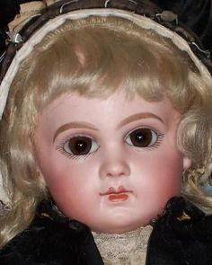 OVERVIEW: This is an exquisite example of an EJ Bebe. She has perfect bisque, with her original Jumeau wig and hairband. Her original marked body is all original finish. She is dressed in a charming a