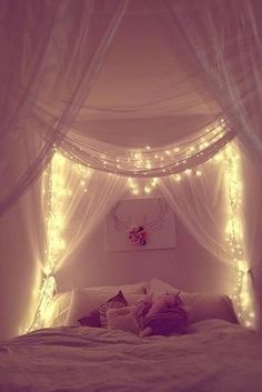 Canopy bed with lights. So romantic.