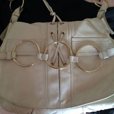 YSL bag White leather bag with shoulder strap - has couple wear marks. Inside immaculate, 2 large pickets outside and I zipped large pocket inside. Yves Saint Laurent Bags