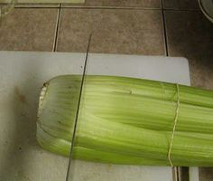 Did you know that you can grow another complete celery stalk from the bottom piece that you cut off and throw away? This is new to me too b...