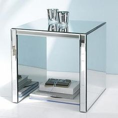 Mirrored side table. (*I would put in a nice soft  cushion underneath for the Cat to use as a bed._LL)