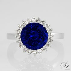 Tanzanite and Diamonds! We can't think of finer combination. This exquisite ring boasts and incredible velvety, blue Tanzanite framed in a glittering Diamond halo. Because everyday should feel special!
