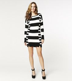 #DYNHOLIDAY Stripe a pose! This striped sweater dress is perfect for the cold season! Pair it with your knee high boots.