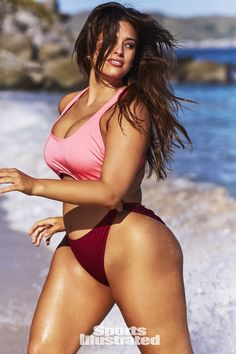 Ashley Graham was photographed by Josie Clough in Nevis. Swimsuit by Swimsuits for All x Ashley Graham.