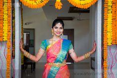 South Indian bride. Gold Indian bridal jewelry.Temple jewelry. Jhumkis. Pink and blue silk kanchipuram sari.Braid with fresh flowers. Tamil bride. Telugu bride. Kannada bride. Hindu bride. Malayalee bride.Kerala bride.South Indian wedding.