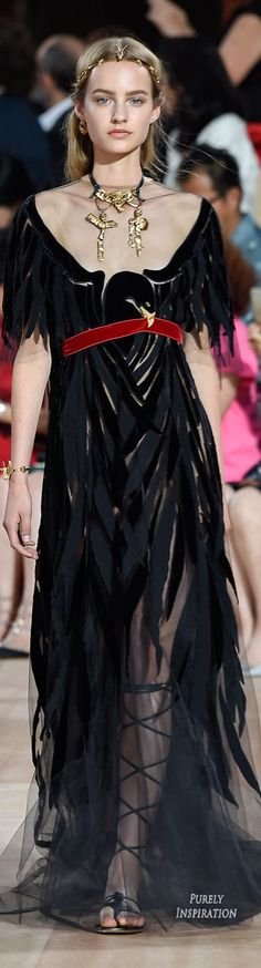 Sometimes when you are cranky you want a dress that looks like it's made from the wings of giant ravens. Valentino understands.