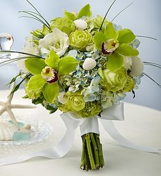Beach #Wedding Mixed Bouquet- long-stem green roses, blue hydrangeas, green mini hydrangeas, green Cymbidium orchid blooms (only in large), white lisianthus, bear grass and variegated pittosporum, bound with a white double satin ribbon $50.00- $135.00