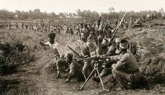 """French """"Tirailleurs"""" (Light African infantry) in Madagascar, training with a Hotchkiss MMG."""