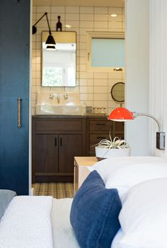 Pop of red. Love those schoolhouse sconces
