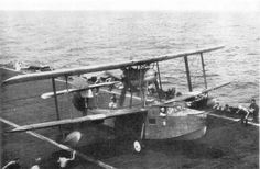 Supermarine Walrus flying boat lands the deck of an aircraft carrier in the Indian Ocean. Royal Navy Aircraft Carriers, Navy Carriers, Ww2 Aircraft, Military Aircraft, British Aircraft Carrier, Float Plane, Sea Plane, Royal Australian Air Force, Flying Boat