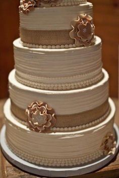 Rustic wedding cake with burlap...don't like the flowers but like the colors!