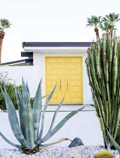 White brick lets this pastel yellow door really pop. | Photographer: Salty Canary