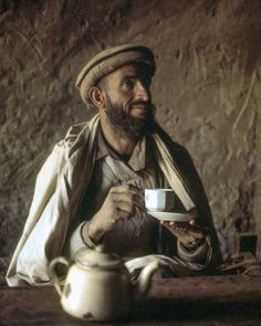 While he waits for a ride in a jeep in an earthen hut north of Chitral Pakistan a Balti man enjoys a cup of chai. Photo from my book #VanishingAsia #Chitral #Pakistan
