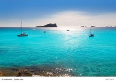 Cala Conta Beach (Platges de Comte) near San Antonio, Ibiza, Spain - It is one of the prettiest beaches of Ibiza with turquoise waters and fine sand. Popular with tourists, it is a great spot to catch a sunset.