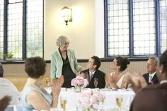 There's a traditional saying about what the mother of the groom is supposed to do – Show Up, Shut Up and Wear Beige. But is that still true in this day and age? Here's a guide to the duties of the mother of the groom, along with ideas on what to wear. Beach Wedding Groom, Wedding Gifts For Bride And Groom, Wedding Attire, Bride Groom, Wedding Hair, Wedding Etiquette, Mother Of Groom Dresses, Mother Of The Bride