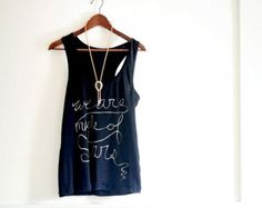 Bleach Painted Tank Top///With a dark colored tank top, a bit of bleach, a craft paint brush, and some basic white chalk, whip up this crazy cool top perfect for all kinds of casual summer occasions!