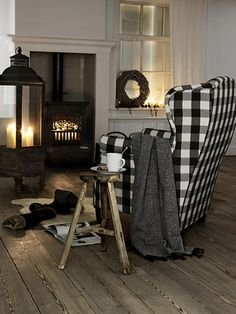 Coffee by the fire. {love that huge lantern!}