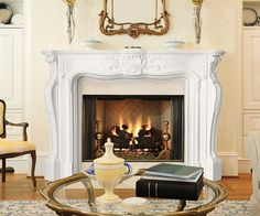 Love Parisian chic? This imposing fireplace surround is an authentic reproduction of eighteenth century French style. Due to the striking details and generous s...