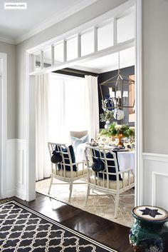Beautiful Christmas home tour featuring the dining room and entryway dressed in blue, white, green and gold for the perfect holiday mix. #christmas #christmasdecor #christmasideas #christmasdecorations