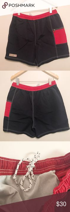 """Vtg Tommy Hilfiger Spellout Swim Trunks Excellent condition! No holes, tears, odors, or stains.  Navy blue/ red Elastic and Drawstring waistband  One side zipper pocket One hip pocket Small pouch inside on waistband  100% Nylon  Measurements:  14.5"""" across waistband  19"""" long  6.5"""" inseam Tommy Hilfiger Swim Swim Trunks"""