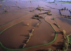 Flooded fields in Cheshire, England. UK. [google map] (© Jason Hawkes) #