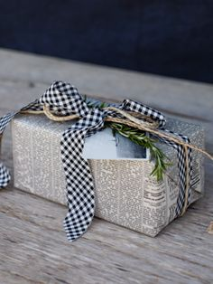 so beautiful! newspaper, twine, gingham and a little green.