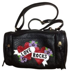 *+If+you+love+a+little+sparkle,+you'll+love+this+glitzy+number!*+Black+faux+leather+barrel+bag*+Leather+and+red+glitter+fabric+Love+Rocks+heart+and+flower+applique+*+Black+tied+zip+pulls*+Zip+fastening*+Zipped+pockets+on+each+end*+Interior+pockets*+Black+lining*+Long+adjustable+strap+*+Measures+approximately+25cm+x+15cm+x+15cm*+This+is+a+one+off+handbag+design