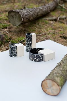 """exercise on pine by gardar eyjólfsson  studio thomas vailly """"in order to reveal the full potential of the material, custom made black resin and pine wood has been delivered to David Derksen, Gardar Eyjolfsson & Lex Pott who each reconfigured a part of the tree into products."""""""