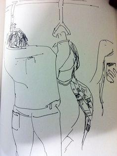 지하철에서 손잡이에 몸을 기댄 남자