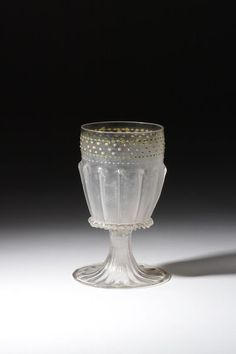 Standing cup     Venice, [Italy] (made)  Date: 1475 - 1525 (made)  Materials and Techniques: Colourless glass, the foot and lower part of the bowl are blown in a dip-mould, enamelled and gilt