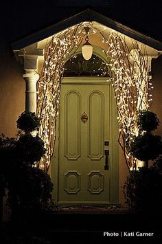 Using branches w/ lights by the front door- beautiful!
