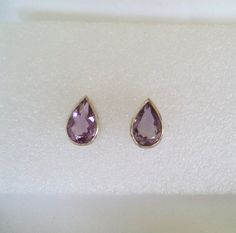 ❘❘❙❙❚❚ ON SALE ❚❚❙❙❘❘     QUALITY ESTATE AMETHYST EARRINGS!!!  Solid 14K White Gold Earrings  Genuine Amethyst Pear Shape Gemstones. 1 1/2 Carat Each Gemstones (Total Carat weight for both earrings are 3 Carat)  They are Stud earrings and weigh 4.3 Grams. The Gemstones measure 12mm by 8mm and pears and have facets Beautiful Color!  PLEASE NOTE: I do not have the original backs for the earrings. Instead of Not including any earrings backs... I do have a Pair of 14k earrings backs to include…