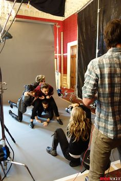 Behind the scenes with One Direction. Why does it look like niall is wearing a leather jacket?!?!