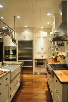 Ultimate Farmhouse Kitchen - traditional - kitchen - louisville - Mike Smith / Artistic Kitchens - Mixed countertop Materials - Pretty much my dream kitchen. Farmhouse Kitchen Decor, Kitchen Remodel, Kitchen On A Budget, Artistic Kitchen, New Kitchen, Home Kitchens, Kitchen Styling, Kitchen Renovation, Kitchen Design