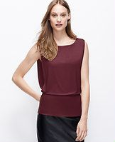 Side Zip Crepe Shell - Exposed side zippers raise the wow factor of our goddess-inspired shell, gorgeously outfitted with a waist-defining peplum hem. Boatneck. Cap sleeves. Peplum hem.