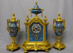 Antique porcelain and ormolu mantel clock set in blue with geometric moorish patterns.