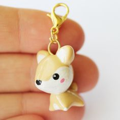 This adorable Fawn Charm is the perfect accessory to add a touch of cuteness to your life! It is made out of strong oven bake polymer clay and all details are painted on with acrylic paint. The eyepin (finding) is secured with super glue to ensure durability. This charm comes on a small go...