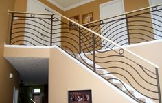 I really love the curved design on these railings.  I think the cast iron would look great in our home as well.  We are remodeling this summer and want to improve our railings.