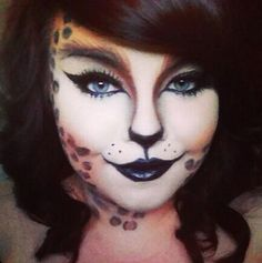 Halloween leopard print cat makeup. Love!! Maybe for next year since I already did the pin up girl look